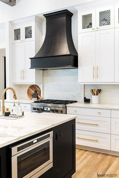 The Black is crossing over to the decorating dark side. A beautiful black range hood picks up the tone of the nearby island.A beautiful black range hood picks up the tone of the nearby island. Modern Farmhouse Kitchens, Black Kitchens, Cool Kitchens, Dream Kitchens, Kitchen Modern, Beautiful Kitchens, Kitchen Hood Design, Kitchen Vent Hood, Kitchen Range Hoods