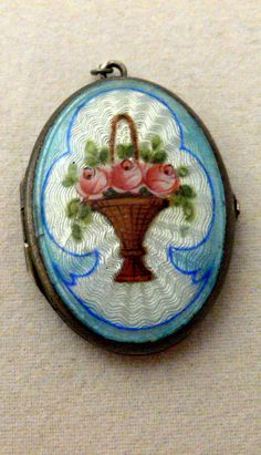 Vintage Sterling Silver Guilloche Enamel Photo Locket with Handpainted Roses.  via Etsy.