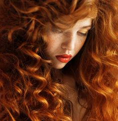 Curly red hair, natural redhead
