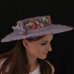 Felicity by Rebeccas Millinery  Floral design crown with floral enhancements around the flat style light purple brim. This hat is trimmed with a floral disc and light purple straw twists; hat elastic included.   Measurements (approx):  Headfitting = 55.5 cm Crown height = 7 cm Distance from bottom of crown to edge of brim = 10.5 cm   Send a message if you would like in a different colour/s