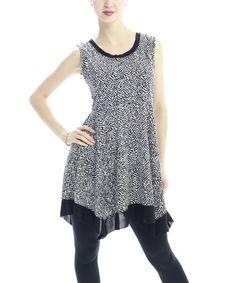 Love this White & Black Ruffle Hem Tunic on #zulily! #zulilyfinds