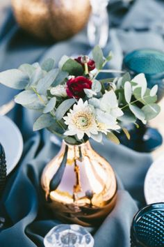 Boho beach wedding reception and decor. Repurpose a wooden bench to act as a table. (You could also upcycle a second hand door. Set it on top of tressel feet, or stacked wooden pallets to create height.) Get 10+ professional tips and ideas for your own bohemian beach wedding! {Styling: Muse Concepts. Photography: Garreth Barclay}