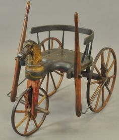 c. 1860, New York City, made of wood with horse head at center and classic long side bars for steering, ornate and very folky making this a nice display piece.