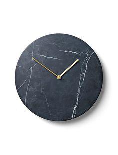 Reloj hecho de Mármol negro.  Me gusta porque se ve moderno y diferente.