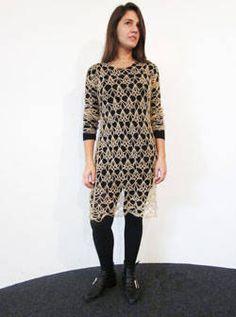 Margherita Missoni wearing a Missoni crochet dress over a black slip