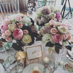 Low lush centerpieces in pinks, cream and champagne.