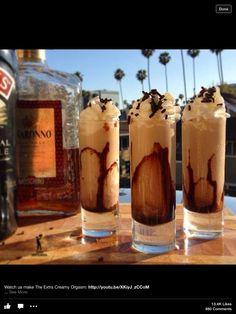 1/2 oz. Ameretto. 1/2 oz  Kahlua. 1/2 oz Baileys. 1/2 oz Creme de Cocoa.  Whipped cream. Chocolate sprinkles