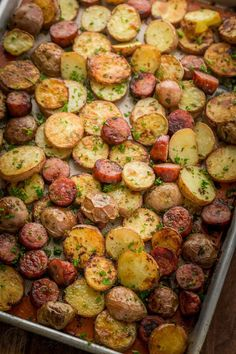 These roasted potatoes are ultra crispy and flavorful with a perfect browning on the coins of kielbasa. Easy, one-pan roasted potatoes and sausage recipe. - I used carrots and parsnips instead of potatoes. This was the best way I've ever eaten kielbasa! Roasted Potatoes And Sausage Recipe, Kielbasa And Potatoes, Kilbasa Sausage Recipes, Recipes With Potatoes, Sausage And Potatoes Skillet, Sausage And Peppers, Russet Potatoes, One Pan Meals, Easy Meals