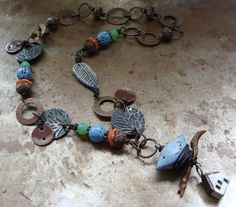 A new necklace using my bird and feather beads.