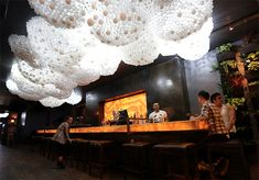 Cloud Ceiling: An Interactive Cloud Made with 15,000 Light Bulbs at Progress Bar in Chicago multiples lighting light installation clouds Chicago