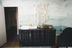 Nursery reveal! Mural by @annie_koelle / Dresser by @knackstudios / Crib & Rug from @potterybarn / Laundry Hamper from H&M / Wall-hanging DIY / Brass boxes Rabbits vintage