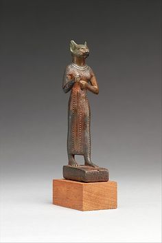 Bastet Period: Late Period–Ptolemaic Period Date: 664–30 B.C. Geography: From Egypt Medium: Bronze, precious metal and black bronze inlays, silver inlay