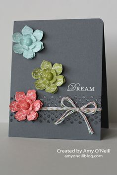 """Supplies Used:  Stamps:  Borderlines, Vintage Vogue, Loving Thoughts  Paper:  Basic Gray and Whisper White Smooth Card Stock  Ink:  Pool Party, Calypso Coral, Lucky Limeade, and VersaMark  Embellishments:  2011-2013 In Color Designer Printed Brads, White Stampin' Emboss Powder, Clear Stampin' Emboss Powder, Lucky Limeade, Calypso Coral, and Pool Party Baker's Twine, 3/16"""" Corner Punch"""