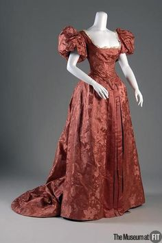 19th century dinner gown. Remove the poofy sleeves and this would be a thousand times better.