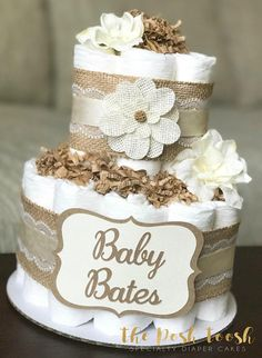 The Posh Toosh Specialty Diaper Cakes make perfect baby shower centerpieces and décor, baby shower gifts, nursery décor, and a unique and practical gift for a mommy-to-be! 2 tier Gender Neutral Shabby Chic Diaper Cake in Cream and Brown Baby Shower Diapers, Baby Shower Favors, Baby Shower Parties, Baby Shower Themes, Baby Shower Gifts, Baby Showers, Shower Ideas, Shower Tips, Shower Party