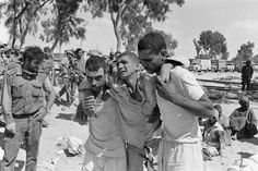 Wounded Egyptian soldiers help rest on each other after being captured by Israeli forces during the Six-Day War, June 9, 1967.