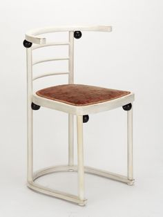 Fledermaus Chair by Josef Hoffmann ▪ 1905 ▪  Hoffmann's chair was designed for the theatre cabaret 'Fledermaus' in Vienna in 1907. It was conceived as a meeting place for the Viennese avant-garde, and this chair model was supplied in both white with black balls and vice versa for the public rooms.