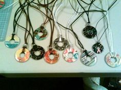 I've made some of these.  They are fun and easy.  Dudleychick Designs: Washer Necklace Tutorial