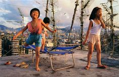 Photo of playing kids on a roof by Ian Lambot   City of Darkness Life in Kowloon Walled city