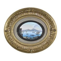 """Gouache on paper depicting the bay of Naples with Mount Vesuvius behind. Framed in a period oval gilt frame. CIRCA: 1860 DIMENSIONS: 14"""" h x 16"""" w"""