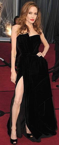 Angelina Jolie in a velvet Atelier Versace gown, with Salvatore Ferragamo peep-toes and millions worth of Neil Lane jewels.