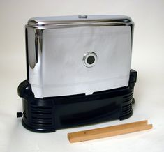 The Walking Toaster (c. 1940s)  You put in bread in one end, watch it going by in the little porthole window, and it comes out toast on the other end. The bread moves through the toaster propelled by a clever mechanism driven by a little motor.