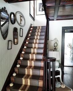 Gorgeous hand painted stair runner gallery wall with antique mirrors and frames pumpkins on stairs fall decorating ideas
