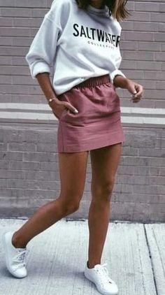 sporty chic style. sweatshirt + mini skirt. sneakers.