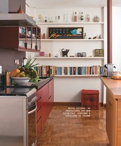 Bookcase/small shelf in the kitchen - oh yea... cookbooks and pictures would be perfect there