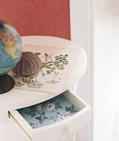 Wallpaper as Drawer Liners - For a flash of style with every pull, line the inside of a drawer with wallpaper cut to fit. Attach with double-stick tape or removable mounting squares so the lining won't shift when you're rummaging for a sock's mate in a pre-coffee morning daze.