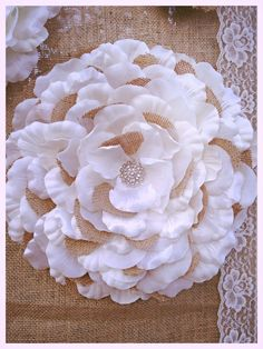 Fabric flowers on burlap backdrop