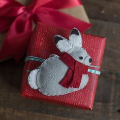 Make this felt Christmas bunny. Perfect as a gift topper or as an ornament. Pattern and tutorial by handcrafted lifestyle expert Lia Griffith.