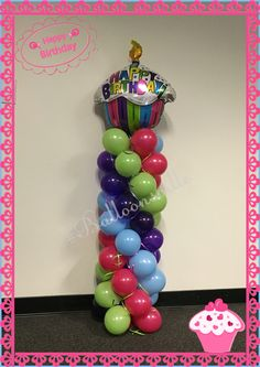 Cupcake Theme balloon decor. Lime green,hot pink, purple and baby blue spiral column w/cupcake topper. #Balloonsville