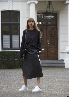 COS sweater, Maje Jacron leather wrap skirt, Axel Arigato 'Clean 360' sneaker, Ralph Lauren bag.