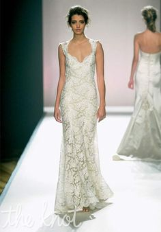 Sleeveless, lace wedding gown with straps and features juliet neckline and open back.