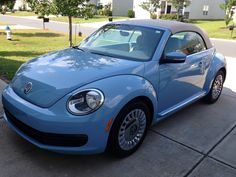 Our new Luv Bug!  2013 Denim Blue VW Beetle Convertible.  We love the tan top too!