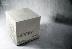 concrete table. It's a perfecet cube with a 50x50 cm countertop that weighs 25 kgs!