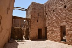al-Ula | Street view to a wooden gate in old town | Archnet