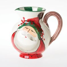 VIETRI Old St. Nick Pitcher | the Old St. Nick Pitcher is the perfect size for a small batch of spiced cider or hot cocoa. Give as a gift to your favorite hostess of place on your buffet for your go-to pitcher this holiday season. #holidays #pitchers