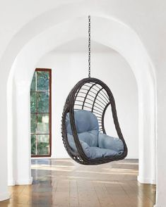 Having a great hammock or a swing in your backyard is cool, but putting one up inside your home? Now that's a refreshing way to give a new meaning to hanging out. There's something extra cozy (not to mention totally chic) about indoor hammocks and hanging chairs—it's like you can just curl up and float on cloud nine right there in your living room. No matter what your style is, from rainbows to macramé, there's a hanging retreat for everyone on this list. Indoor Swing, Indoor Hammock, Hammock Chair, Hammocks, Hanging Chairs, Hanging Out, Cozy Family Rooms, What's Your Style, Rainbows