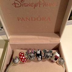 "Pandora  Disney & Mickey Minnie Set of 5 Charms Authentic Pandora Disney  Limited Edition Sparkling Mickey & Minnie Portrait set and 3 Muranos, 5 Pandora Charms Total:   -Sparkling Mickey Portrait, LE($90) -Sparkling Minnie Portrait, LE ($90) -1 Pandora Classic Minnie Murano ($50) -1 Pandora ""Minnie's Signature Look"" Murano ($50) -1 Pandora Mickey Murano ($50)  = Originally retails for $330 + tax in stores.  Comes with a foldable Pandora Charm box   Minnie Mickey Pandora Disney Limited…"