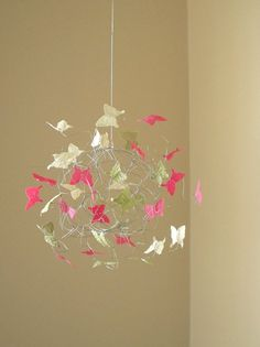 Butterfly nursery mobile. DIY-Pink and Green Yarn globe (using balloon/glue method) and stick lavender butterflies all around ;)