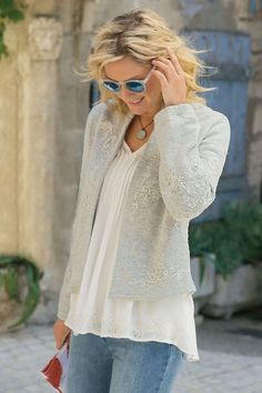 "A celebration of special touches, this superbly soft jacket swirls with garlands of soutache embroidery, placed to flattering effect on both the body and the long sleeves. Brushed French terry with an open front and stand collar. Cotton/viscose. Misses 21""/23"" long. Festoon Knit Jacket #2AL04"