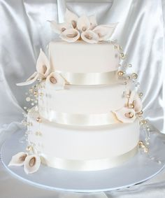 Ivory Calla Lilly Wedding Cake by Say it with Cake, via Flickr