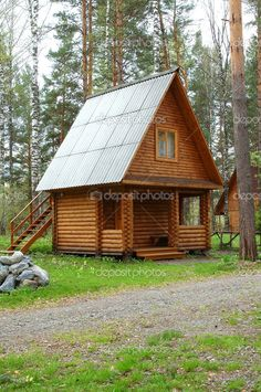 Small Wooden House | Wooden small house in a wood - Stock Image