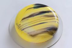 Yellow mousse cake with mirror glaze