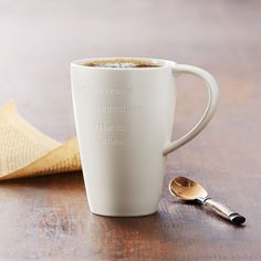 A+grande-size+coffee+mug+inscribed+with+an+inspirational+message.