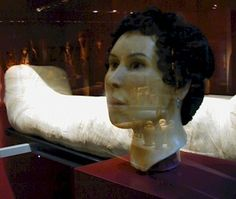 The mummy of Sensaos, a Roman era girl, dates from 109 AD. The mummy itself is plainly wrapped. Scientists were able to take images of Sensaos's head and reconstruct her face. This is now displayed along with her mummy.