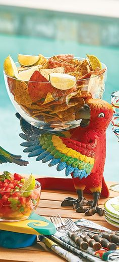 Coming straight from Margaritaville, this party-ready parrot was designed in-house to serve up something delicious to all the Parrotheads at your next island-inspired soiree. | Margaritaville by Frontgate