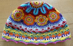 crochet motif hat-gorgeous! not in English but translator works fairly well. It's illustrated...didn't see a pattern.
